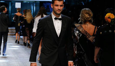 Tennis player Grigor Dimitrov on the catwalk during Dolce and Gabbana fashion show