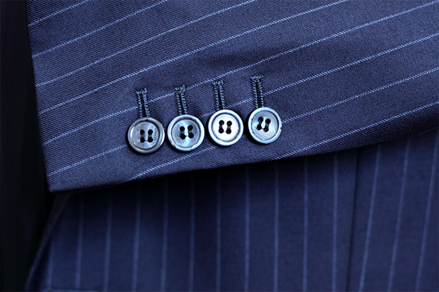 The suit details: Working cuffs and kissing buttons