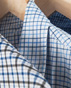 A high performance, machine washable, dress shirt that never wrinkles